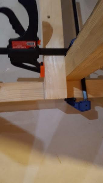 use 2 clamps and block to keep frame square