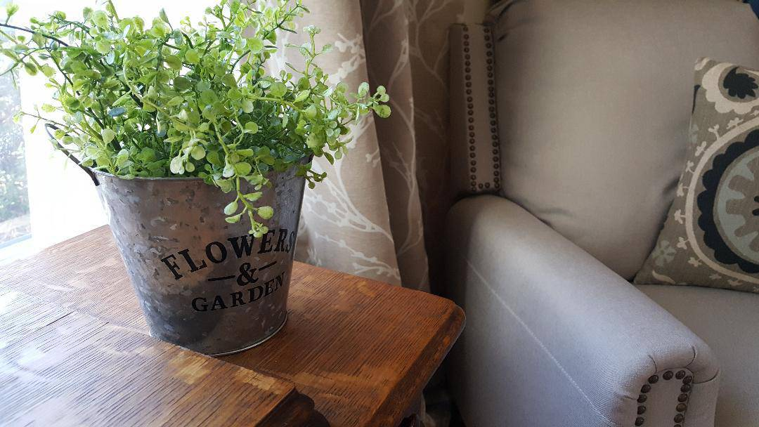 Farmhouse Galvanized Metal Bucket with Greenery & Armchair Recliner