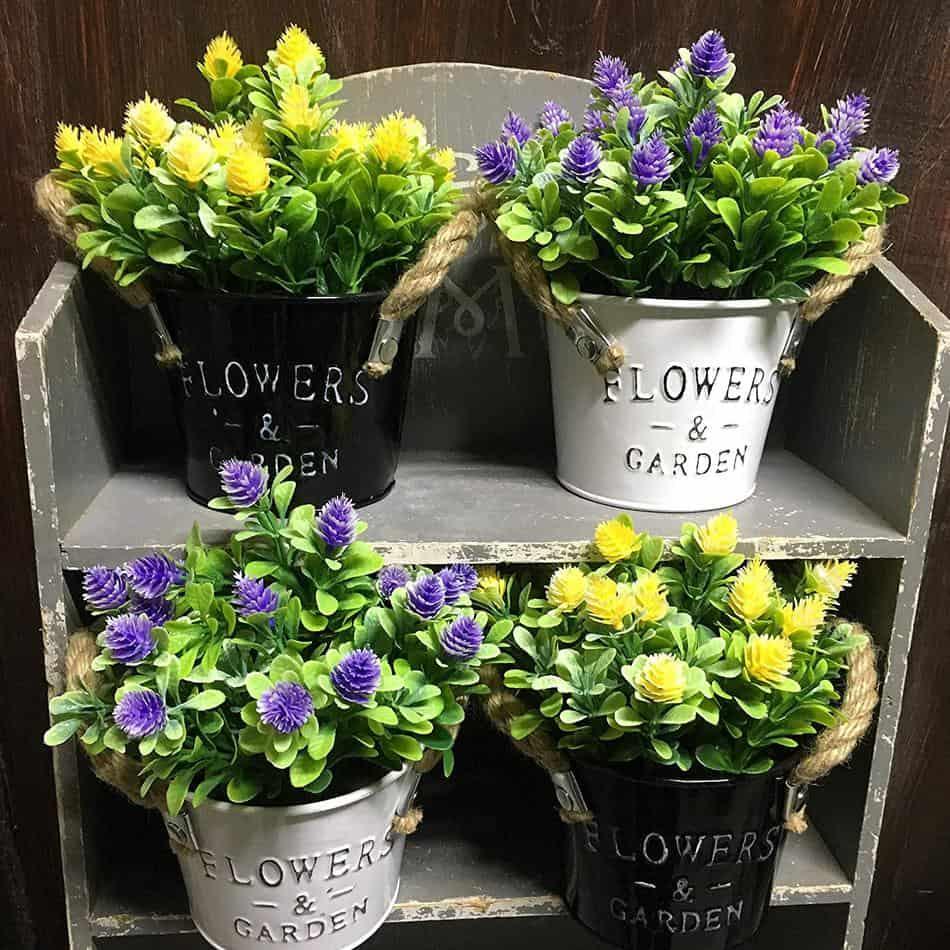 Set of 2 metal flower pots w/ faux flowers`