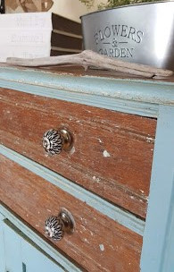 Farmhouse style drawer pulls, books stack, chippy