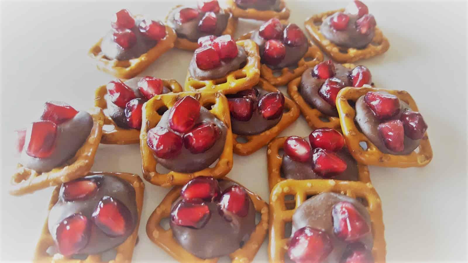 Chocolate & Peppermint Pom Pretzel Bites - Candy Cane Hershey Kisses